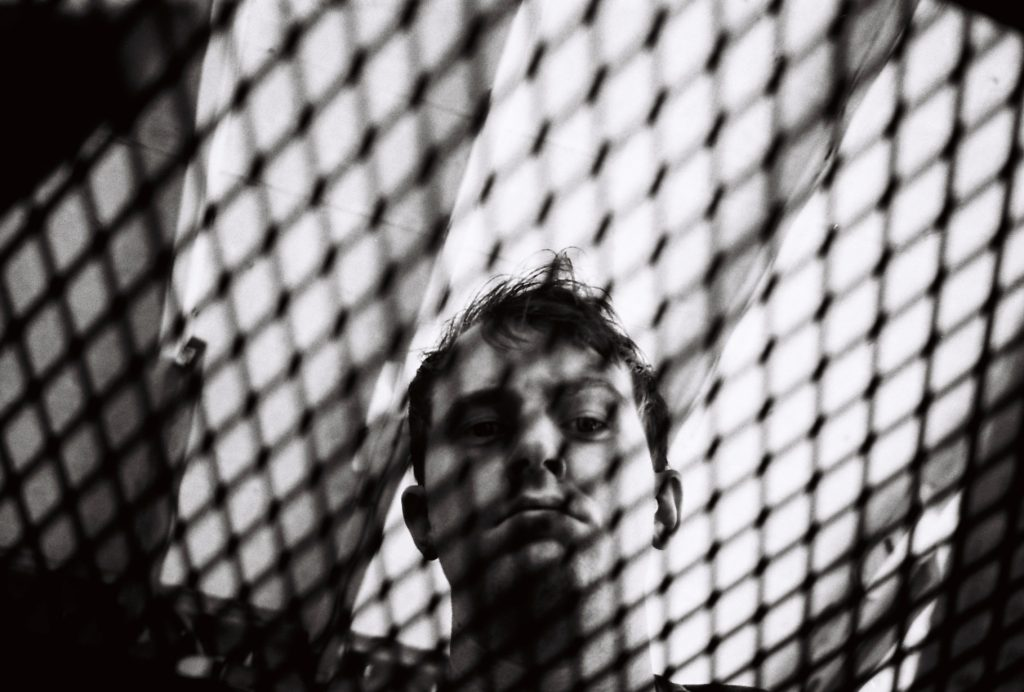 Self-portrait of Zack through grate